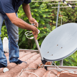 worker-installing-satellite-dish-and-antenna-on-PAVCCF8